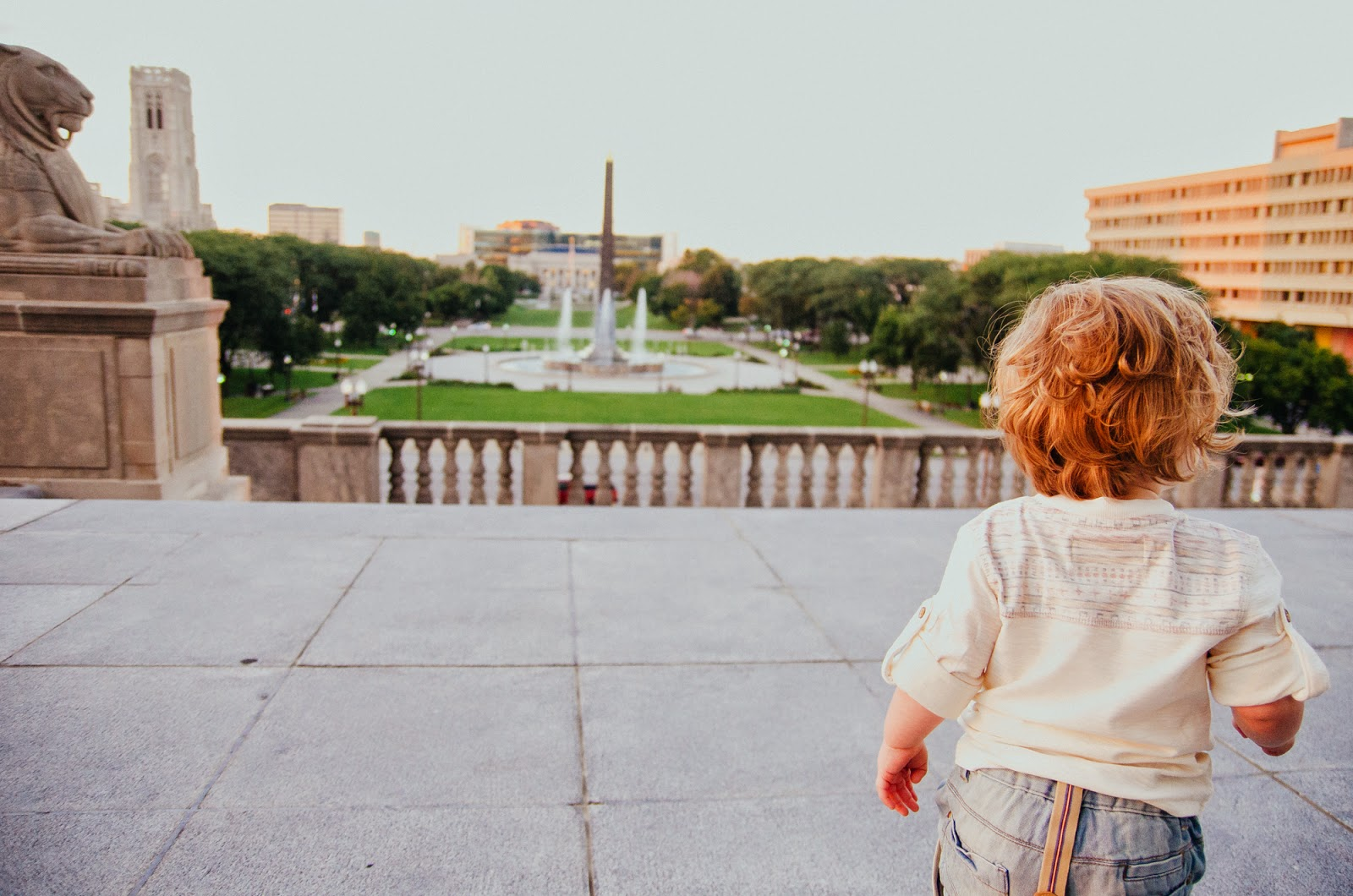 little boy looks over indianapolis towards central public library