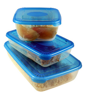 Three food containers with leftovers