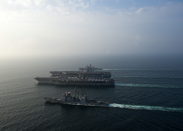 USS Enterprise (CVN 65), the Nimitz-class aircraft carrier USS Dwight D. Eisenhower (CVN 69) and the Ticonderoga-class guided-missile cruisers USS Vicksburg (CG 69) and USS Hue City (CG 66)