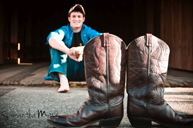 senior with cowboy boots in front of him