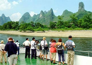 Visitors viewing the beautiful scenery of Li River on the cruise ship