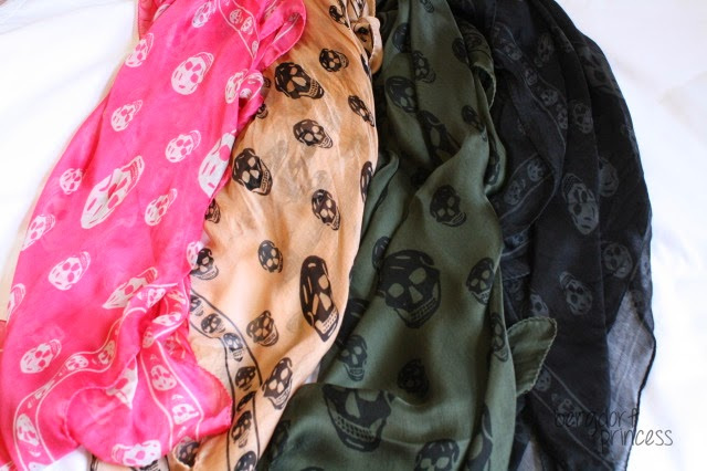 Alexander McQueen silk skull scarves in neon pink, blush pink, olive green, and black and gray