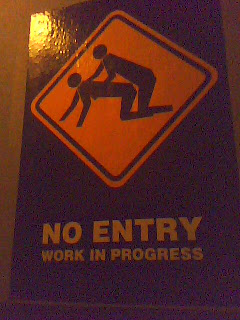 funny sign: no entry work in progress