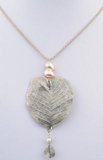 https://www.etsy.com/listing/90505612/silver-leaf-pendant-with-pearls-silver?
