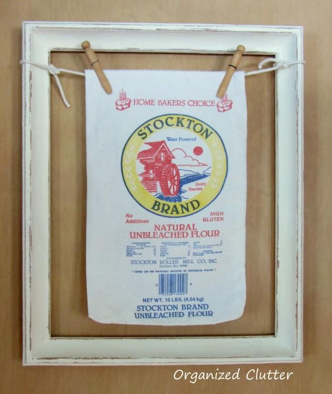 A Framed Cloth Flour Sack www.organizedclutterqueen.blogspot.com