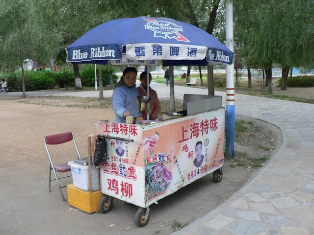 food cart with Pabst Blue Ribbon Beer umbrella