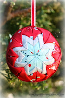 http://www.aspoonfulofsugardesigns.com/2013/10/folded-star-ornament.html