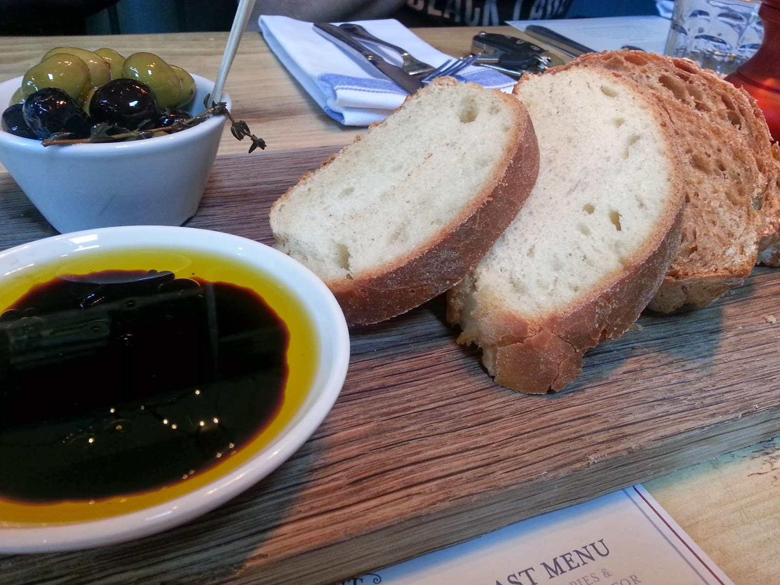 Bread and olives with balsamic and olive oil dip
