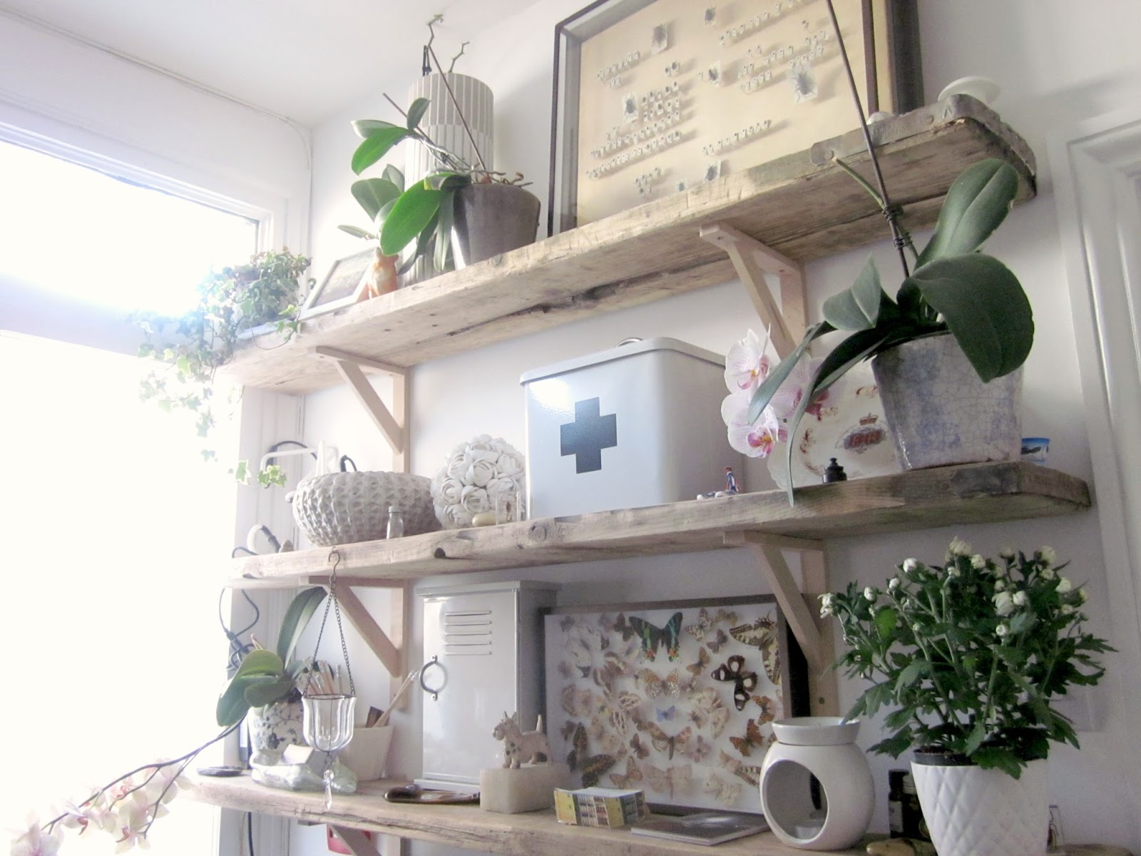 wooden shelves with lots of accessories