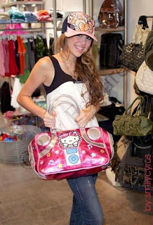 Miley Cyrus (Hannah Montana) with Hello Kitty bag