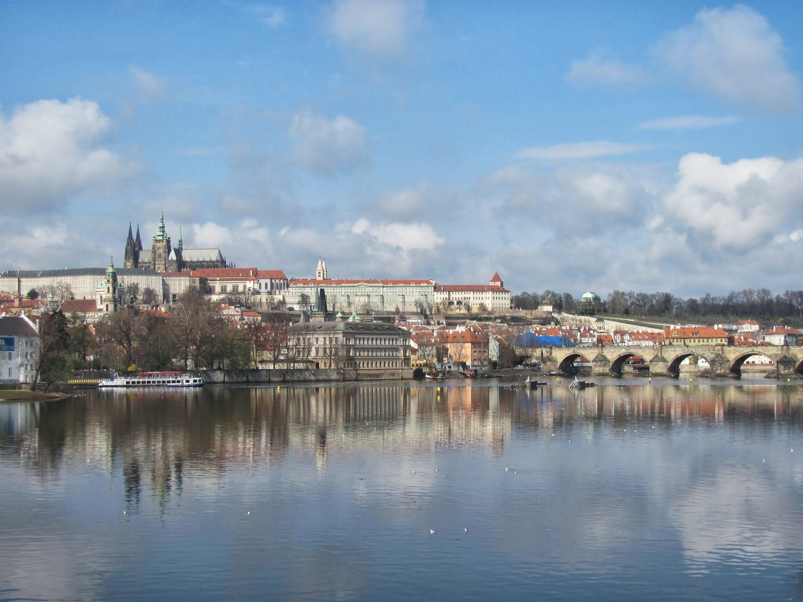 Prague Castle (top left) and Charles Bridge (right)