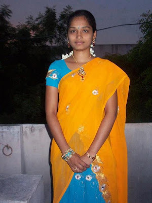 Homely Tamil village girl in saree.