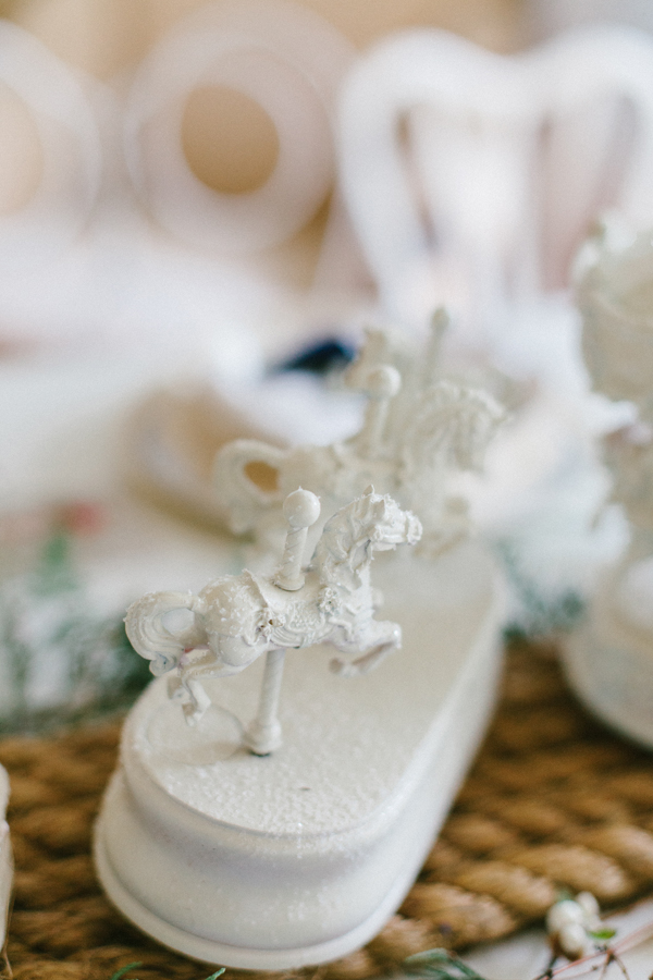 Thrifted carousel horses spray painted white & glittered at www.vintagewhitesblog.com
