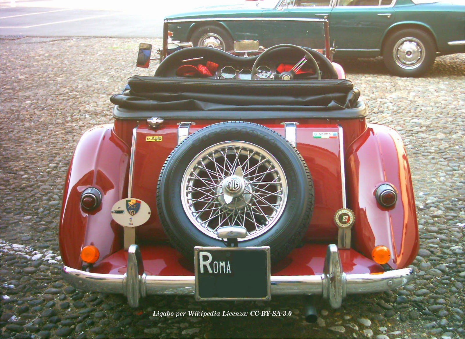 The MG TF was the last of the traditionally-styled MGs with a wood-framed body, separate wings, and running boards.