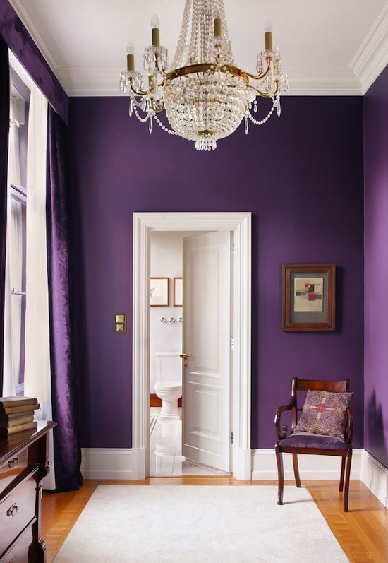 purple walls with crystal chandelier