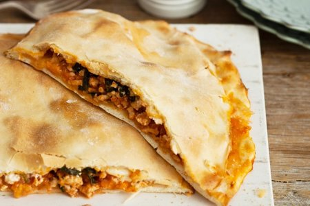 Try this classic Turkish dish of chicken Chicken, spinach and feta pide recipe
