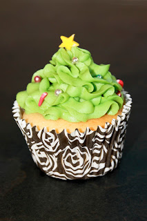 Christmas tree cupcake with silver baubles and candy cane sprinkles