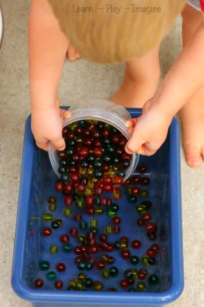 Sensory play with apple scented water beads