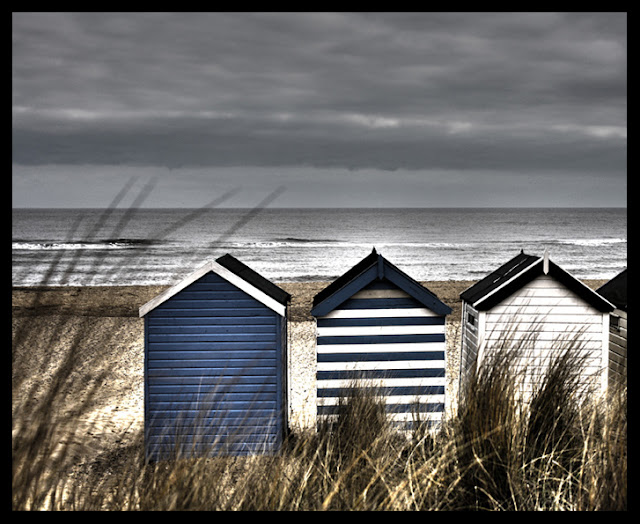 Beach Huts - Beach Houses - North Sea Coast - Photograph by Tim Irving