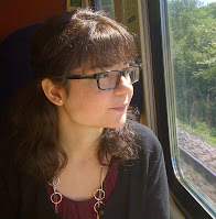 Portrait photograph of Valerie-Anne staring out of a train window