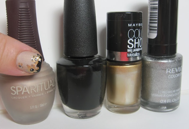 Bottle shot:  SpaRitual Mind, OPI Black Onyx, Maybelline Bold Gold, and Revlon Sequin.