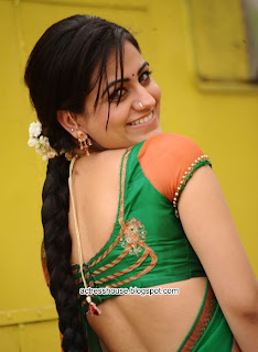 Aksha hot sizzling saree stills
