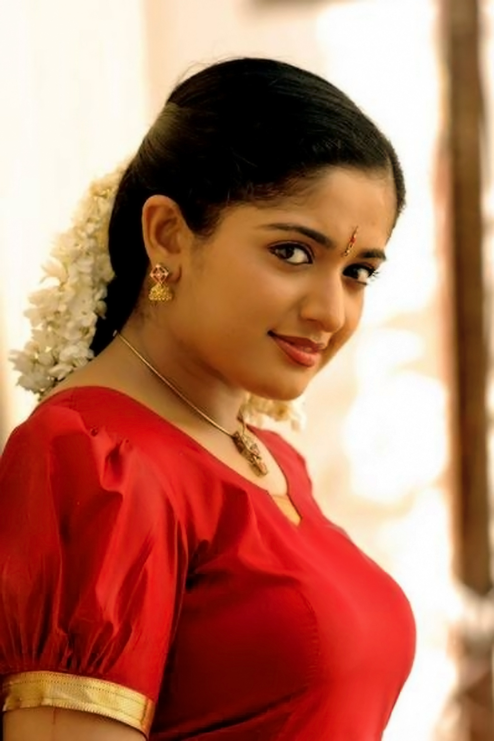 malayalam actress kavya madhavan in red and other blouse