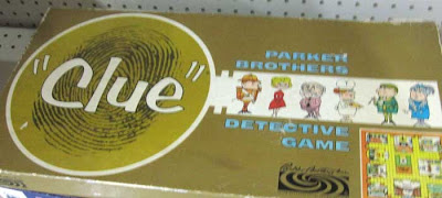 1960s Clue box, gold with huge magnifying glass and thumbprint