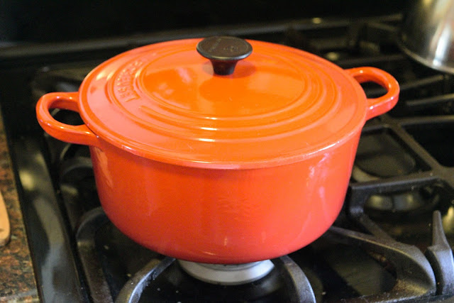 The pot, on the stove, with the lid on.