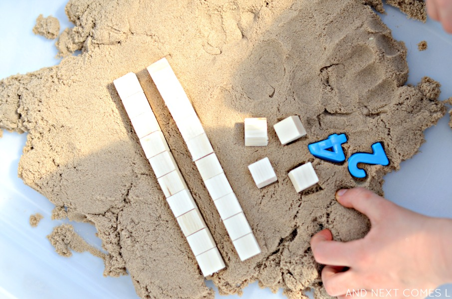 Counting with base ten blocks and kinetic sand - fine motor math activity for kids from And Next Comes L