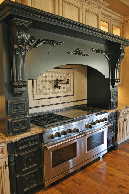 custom built black carvings on the kitchen exhaust ventilator