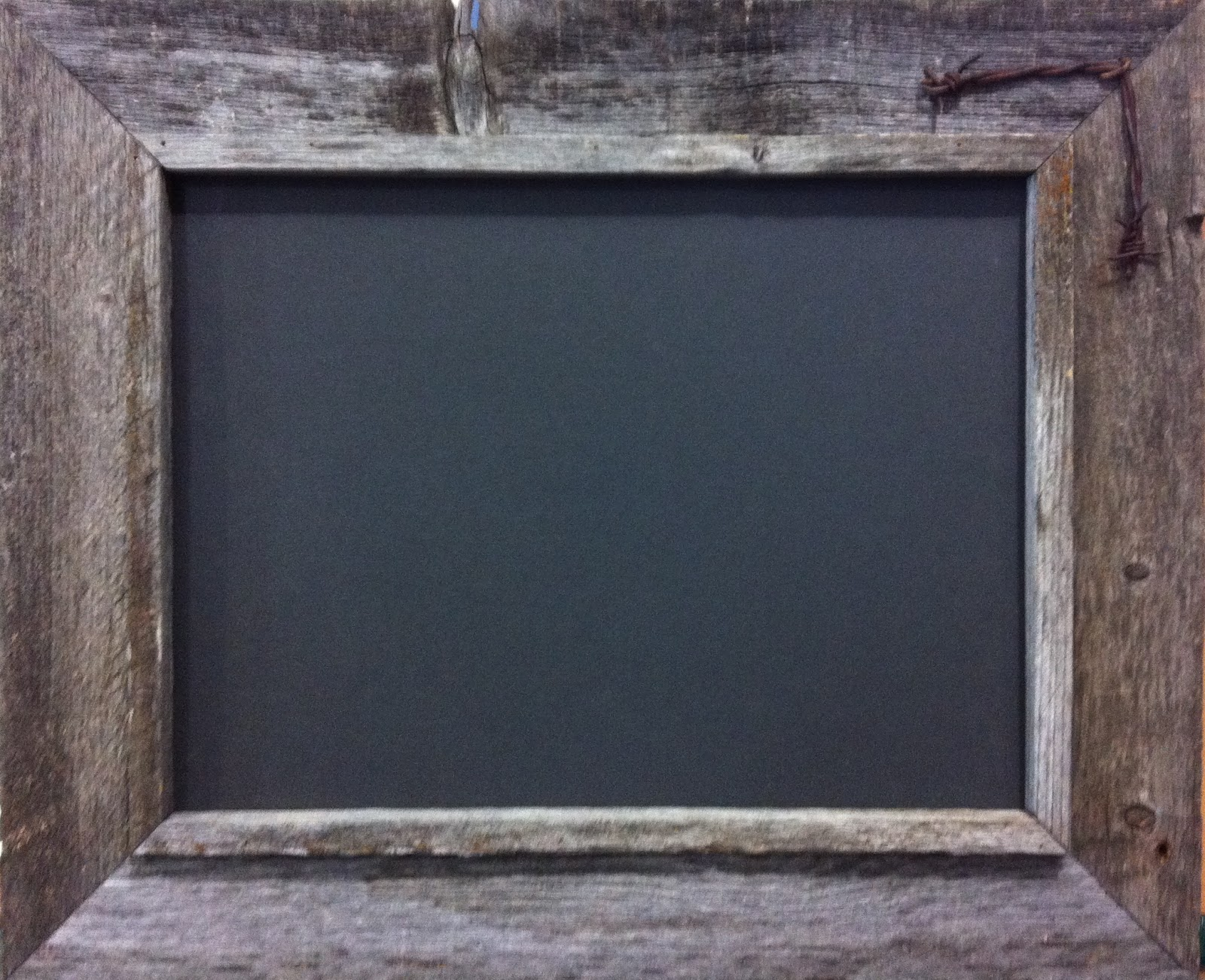 barn wood frame with barbed wire corner