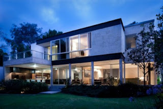 front house design minimalist  with interior lights at night