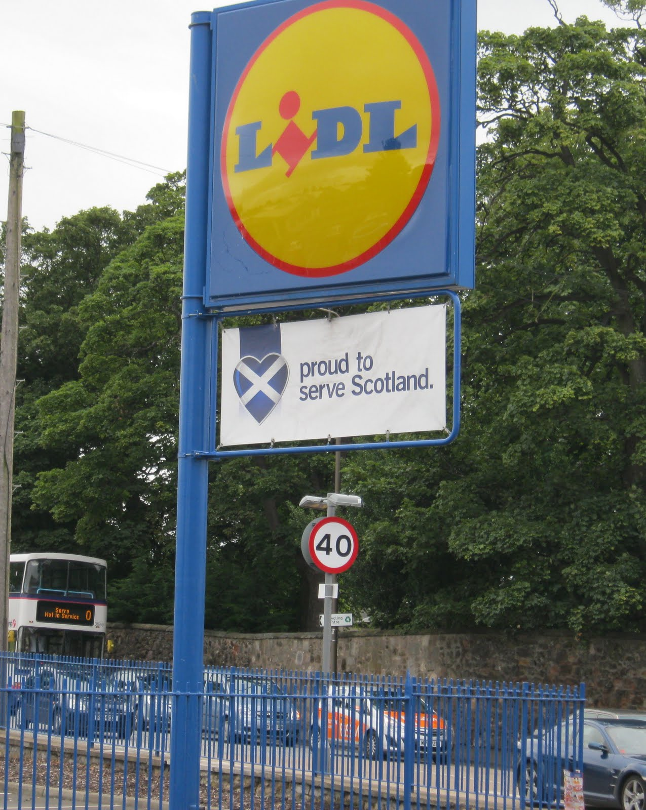 Lidl sign with Saltire saying Proud to Serve Scotland