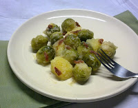 Coles de Bruselas a la Lionesa con Tomates Secos