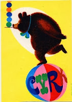 a polish poster of a circus bear on a ball