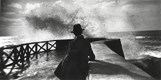 man with hat, jetty, storm
