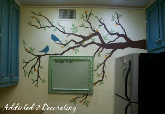 hand painted tree mural on wall