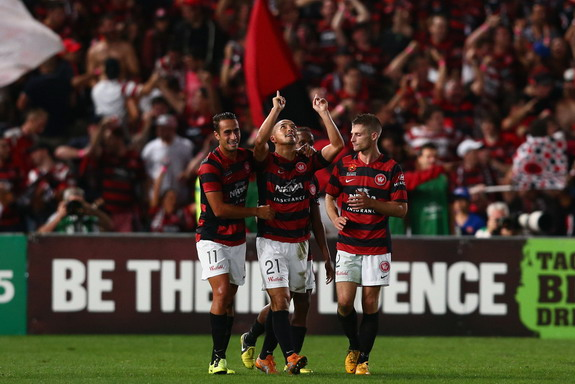 Shinji Ono celebrates with Western Sydney teammates after scoring against Brisbane Roar