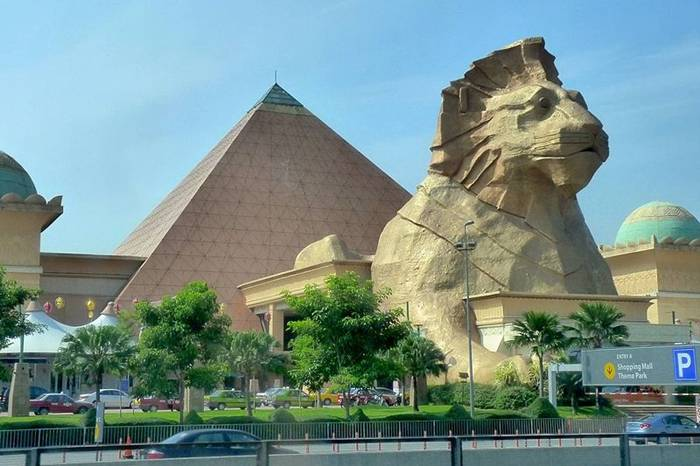"Sunway Pyramid is located in the heart of Bandar Sunway, Subang Jaya. It was opened in July 1997. One of the mall's most easily recognised designs is the Egyptian-inspired Pyramid with a lion ""standing guard"" at the entrance. The rest of the building is embellished in the monumental style, complete with pseudo-hieroglyphics decorating facades, along with numerous Pharonic statuaries. A monorail station connected to the Kuala Lumpur Monorail was originally planned to be built there. Construction began in early 2006, but was stopped and as of 2007 demolition is being considered.Its gross floor area of are totals 4,276,945 square feet (396,000 m²)."