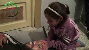 طفلة تودع والدها الشهيد  باذن الله