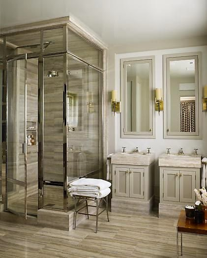 sleek bathroom with striated wood look tile floors glass polished shower enclosure