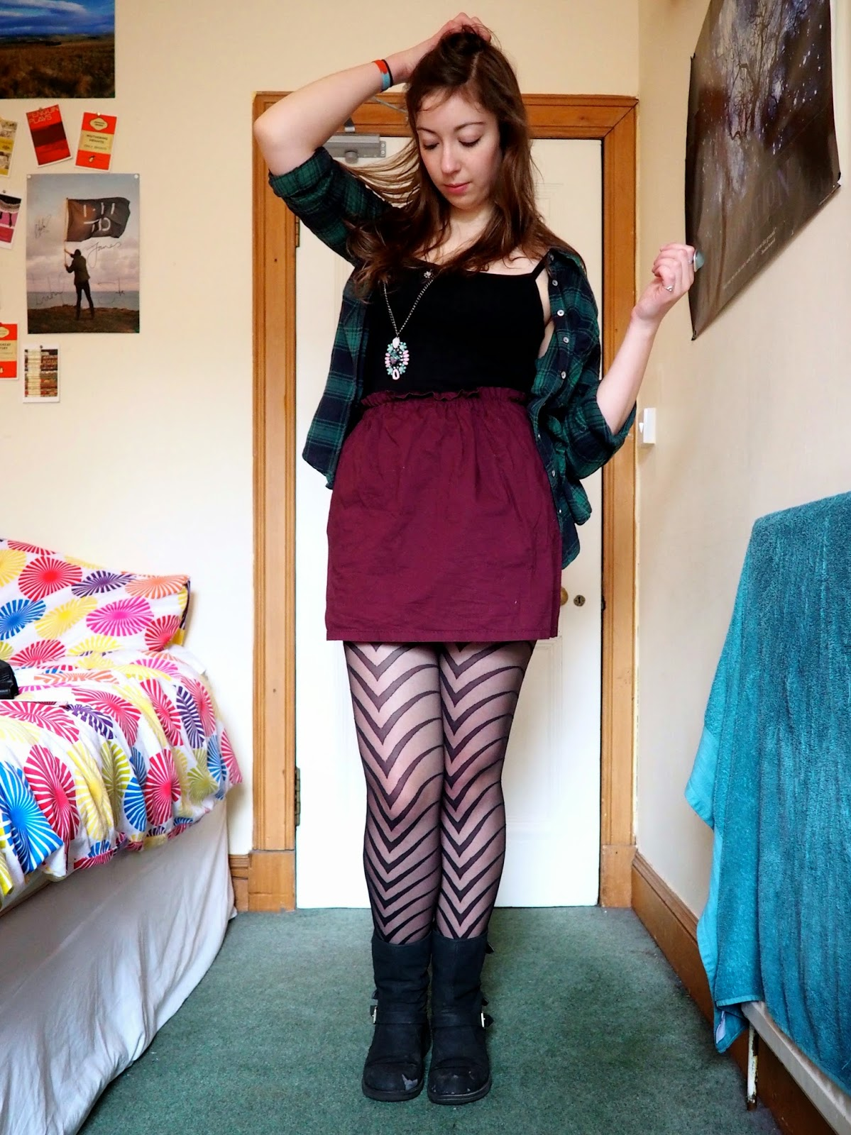 Statement pieces outfit | Green checked shirt, black vest, purple skirt, patterned tights & black biker boots