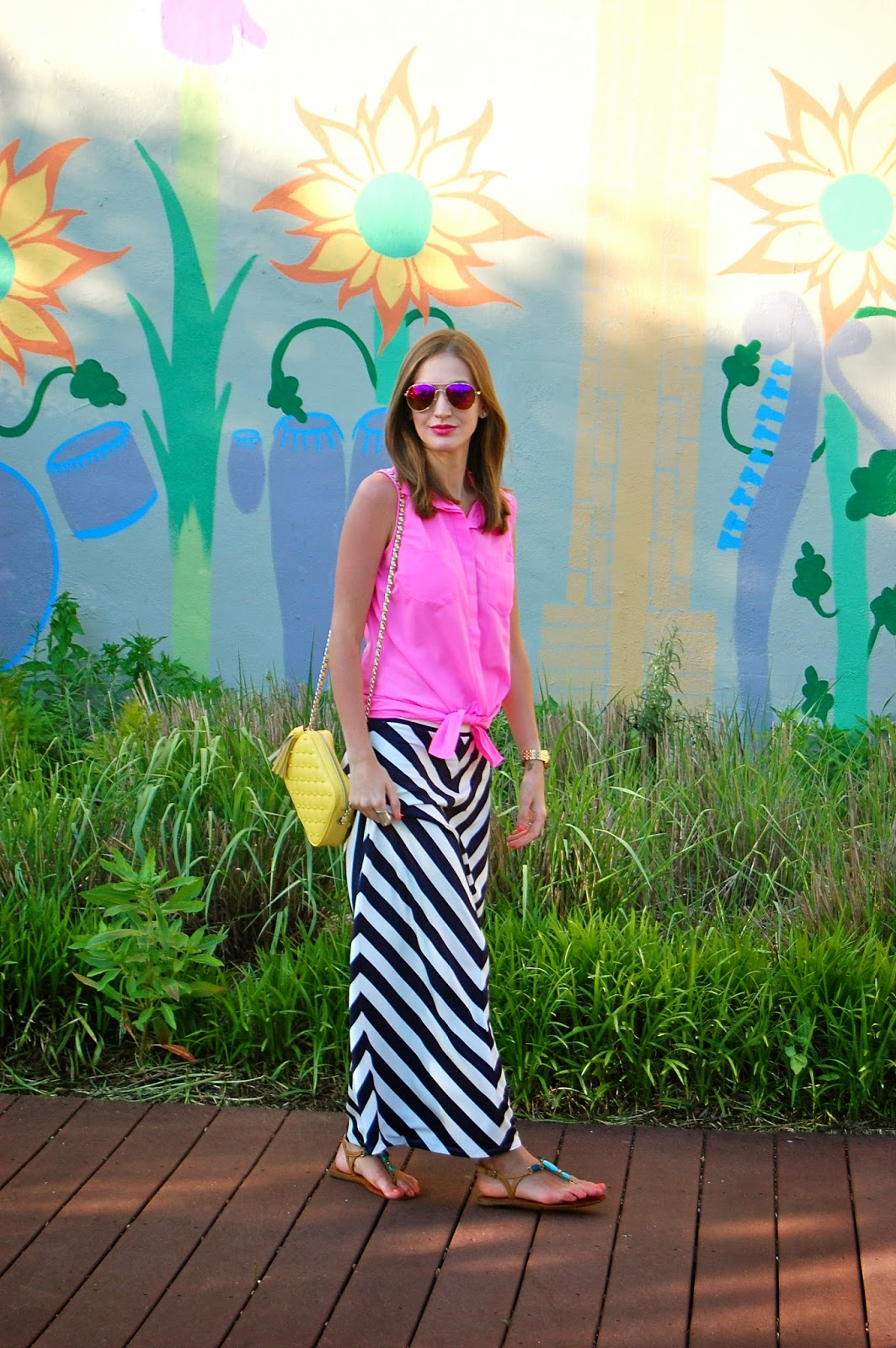 Wearing summer brights, wearing Loft navy striped maxi skirt, hot pink tied blouse, Rebecca Minkoff yellow flirty studded cross body, hot pink mirrored sunglasses