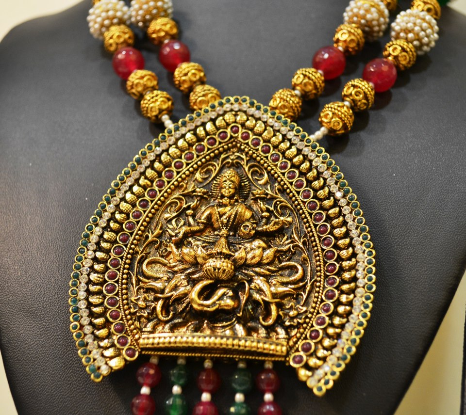 Gold Temple Jewellery Designs View Image