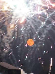 Glowing Moonrise Surrounded by July 4th Fireworks was a Popular 2012 Blog Photo