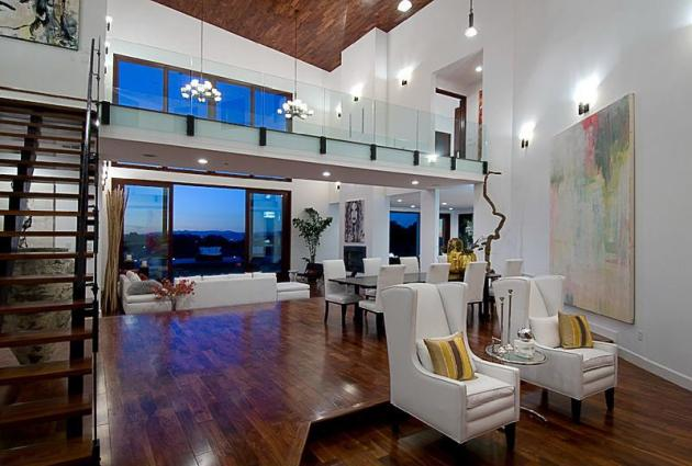 Picture of the interiors of Rihanna's house showing sitting area by the stairs to the gallery