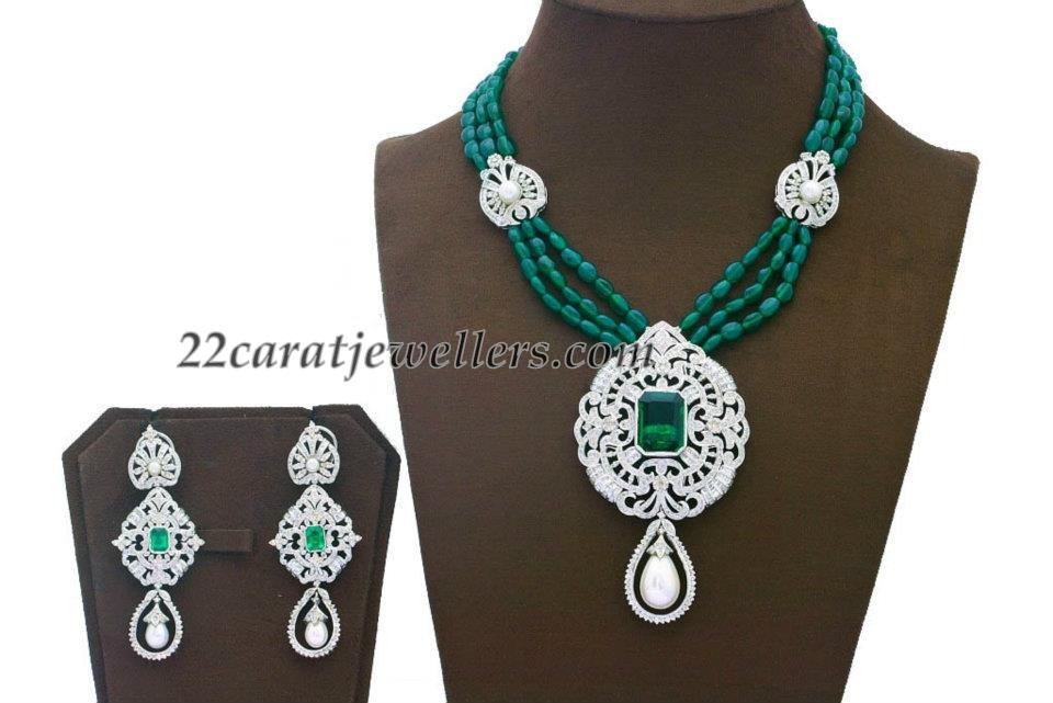 Emerald beads with diamond pendant jewellery designs emerald beads triple strings short necklace attached with designer diamond heavy pendant studded with emeralds paired with matching diamond emerald mozeypictures Choice Image