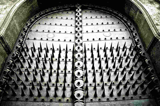 Twelve-inch Steel Spikes arranged in a nine by eight grid in Dilli Darwaza