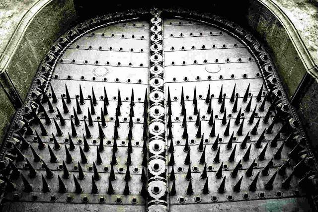 Twelve-inch Steel Spikes arranged in a nine by eight grid in Dilli Darwaza